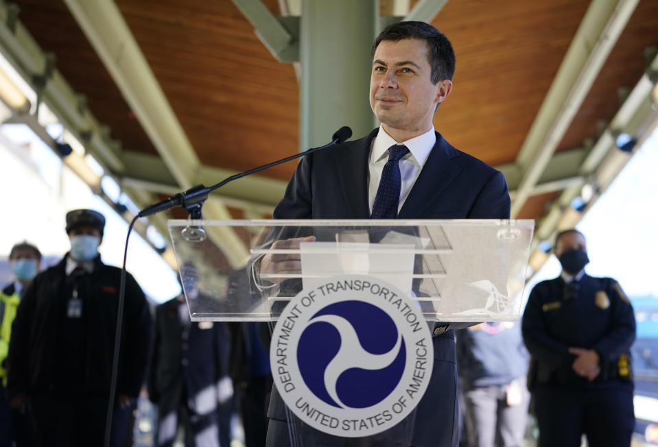 FILE - In this Feb. 5, 2021, file photo Transportation Secretary Pete Buttigieg speaks at Union Station in Washington. Two months into his job, Buttigieg is forging a fresh path for his Cabinet role and in his life that could bridge gaps with Republicans when it comes to President Joe Biden's agenda. (AP Photo/Carolyn Kaster, File)