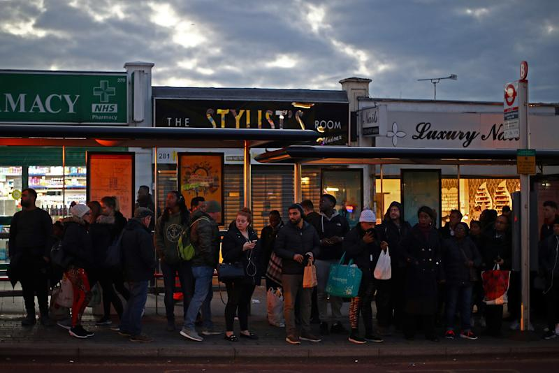 Commuters queue for a bus on a high street in Dagenham, east London, Britain, March 18, 2019. Picture taken March 18, 2019. To match Special Report BRITAIN-EU/DAGENHAM REUTERS/Hannah McKay