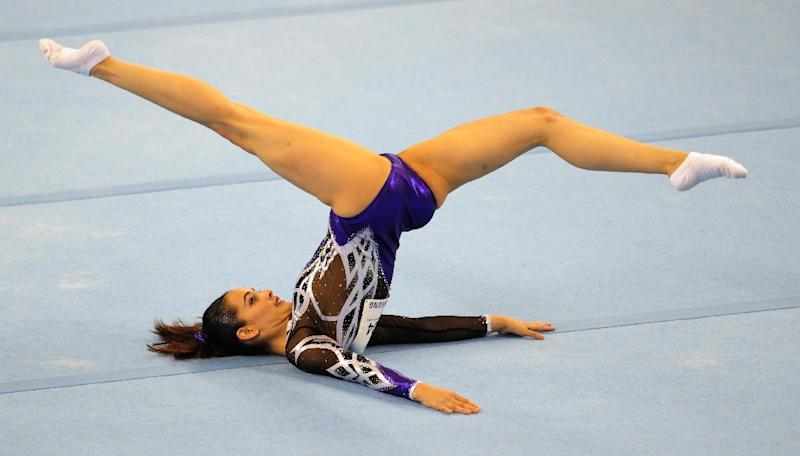 Farah Ann Abdul Hadi of Malaysia competes during the women's floor excercise routine final at the 28th Southeast Asian Games (SEA Games) in Singapore on June 10, 2015