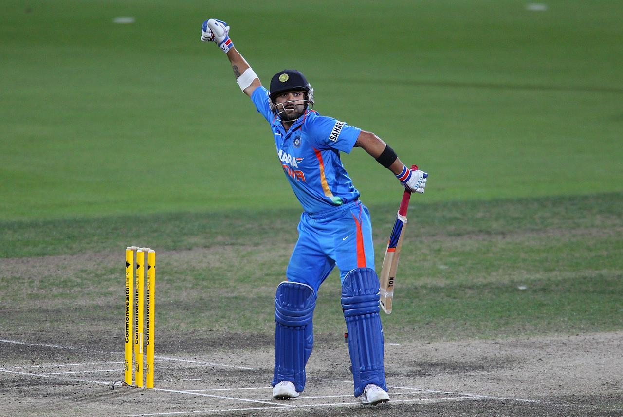 HOBART, AUSTRALIA - FEBRUARY 28:  Virat Kohli of India celebrates after hitting the winning runs during the One Day International match between India and Sri Lanka at Bellerive Oval on February 28, 2012 in Hobart, Australia.  (Photo by Scott Barbour/Getty Images)