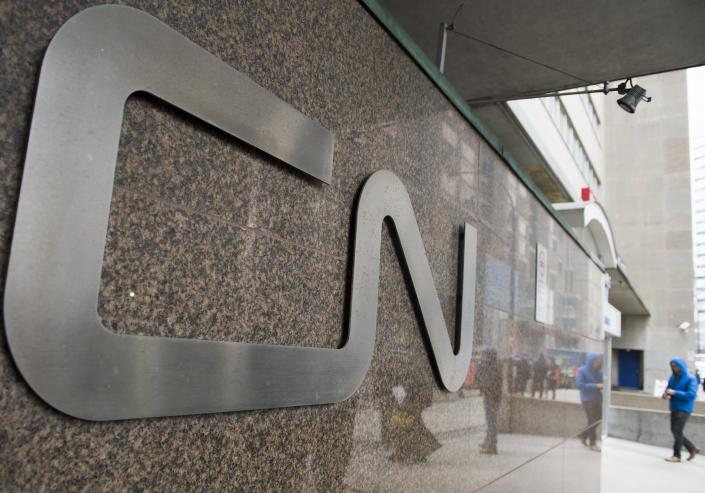 A man walks into Central Station next to Canadian National headquarters in Montreal, Tuesday, Nov. 26, 2019. Canadian National sweetened its offer to buy Kansas City Southern railroad Thursday, May 13, 2021, and derailed rival Canadian Pacific's bid for the railroad that handles traffic in the United States and Mexico. (Graham Hughes/The Canadian Press via AP)