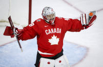 Canada's goalie Emerance Maschmeyer celebrates after the team's win over Germany in an IIHF women's hockey championships quarterfinal in Calgary, Alberta, Saturday, Aug. 28, 2021. (Jeff McIntosh/The Canadian Press via AP)