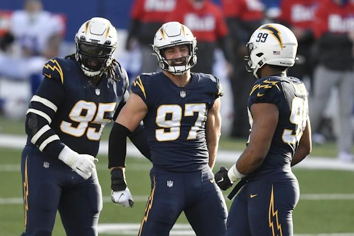 Los Angeles Chargers defensive end Joey Bosa (97) celebrates after sacking Buffalo Bills quarterback Josh Allen.