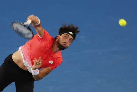 FILE PHOTO: Tennis - Australian Open - Third Round - Melbourne Park, Melbourne, Australia, January 18, 2019. Georgia's Nikoloz Basilashvili in action during the match against Greece's Stefanos Tsitsipas. REUTERS/Adnan Abidi