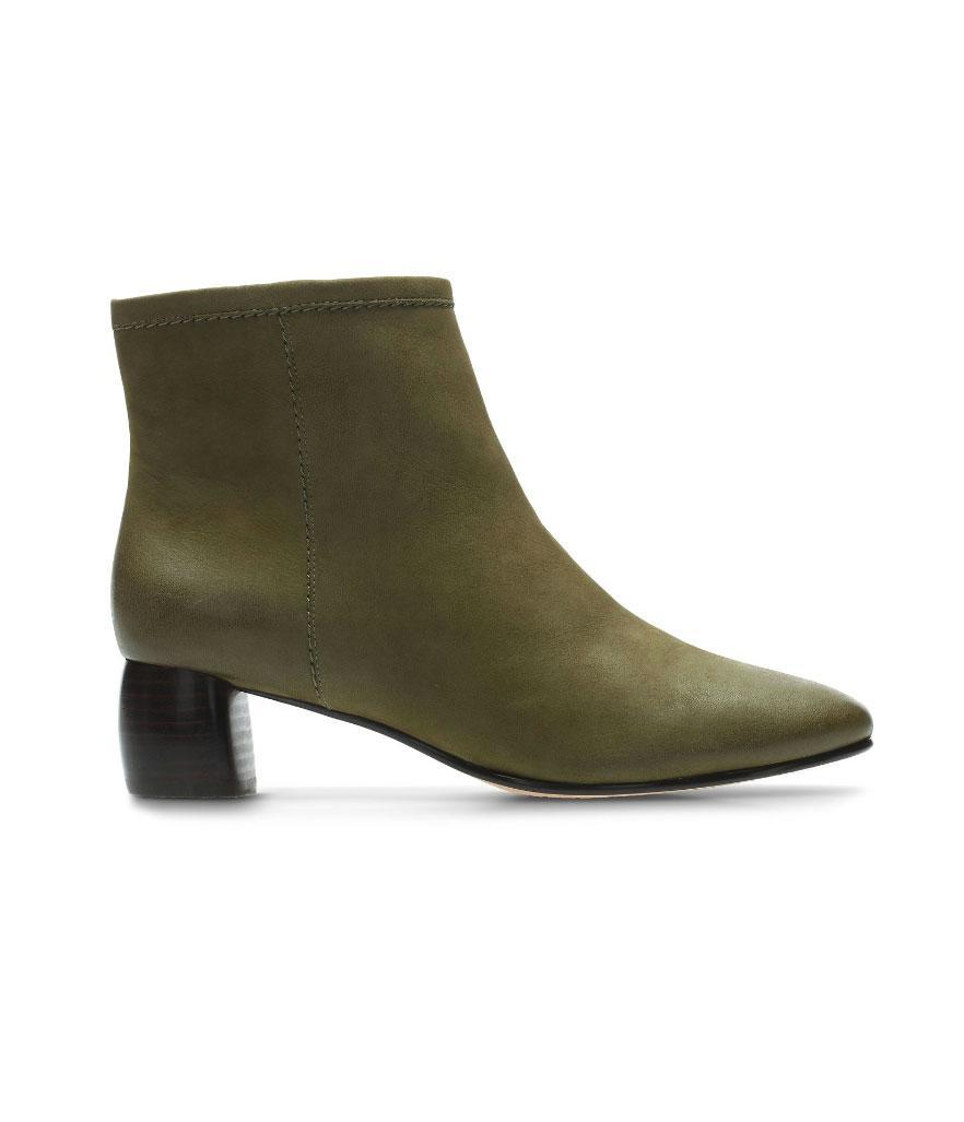 """<p>In a khaki green shade, these boots feature a low heel and a side zipper for easy slip-on access.<br><a href=""""https://fave.co/2PcPvMp"""" rel=""""nofollow noopener"""" target=""""_blank"""" data-ylk=""""slk:Shop it:"""" class=""""link rapid-noclick-resp"""">Shop it:</a> Grace Bella Women's Boots, $80 (was $150), <a href=""""https://fave.co/2PcPvMp"""" rel=""""nofollow noopener"""" target=""""_blank"""" data-ylk=""""slk:clarkusa.com"""" class=""""link rapid-noclick-resp"""">clarkusa.com</a> </p>"""