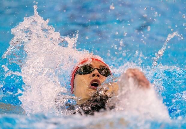 Tokyo-bound Kylie Masse of Lasalle, Ont., swims her way to first place in the Women's 200-metre Backstroke at the 2020 Olympic Swimming Trials in Toronto on Wednesday. (Frank Gunn/The Canadian Press - image credit)