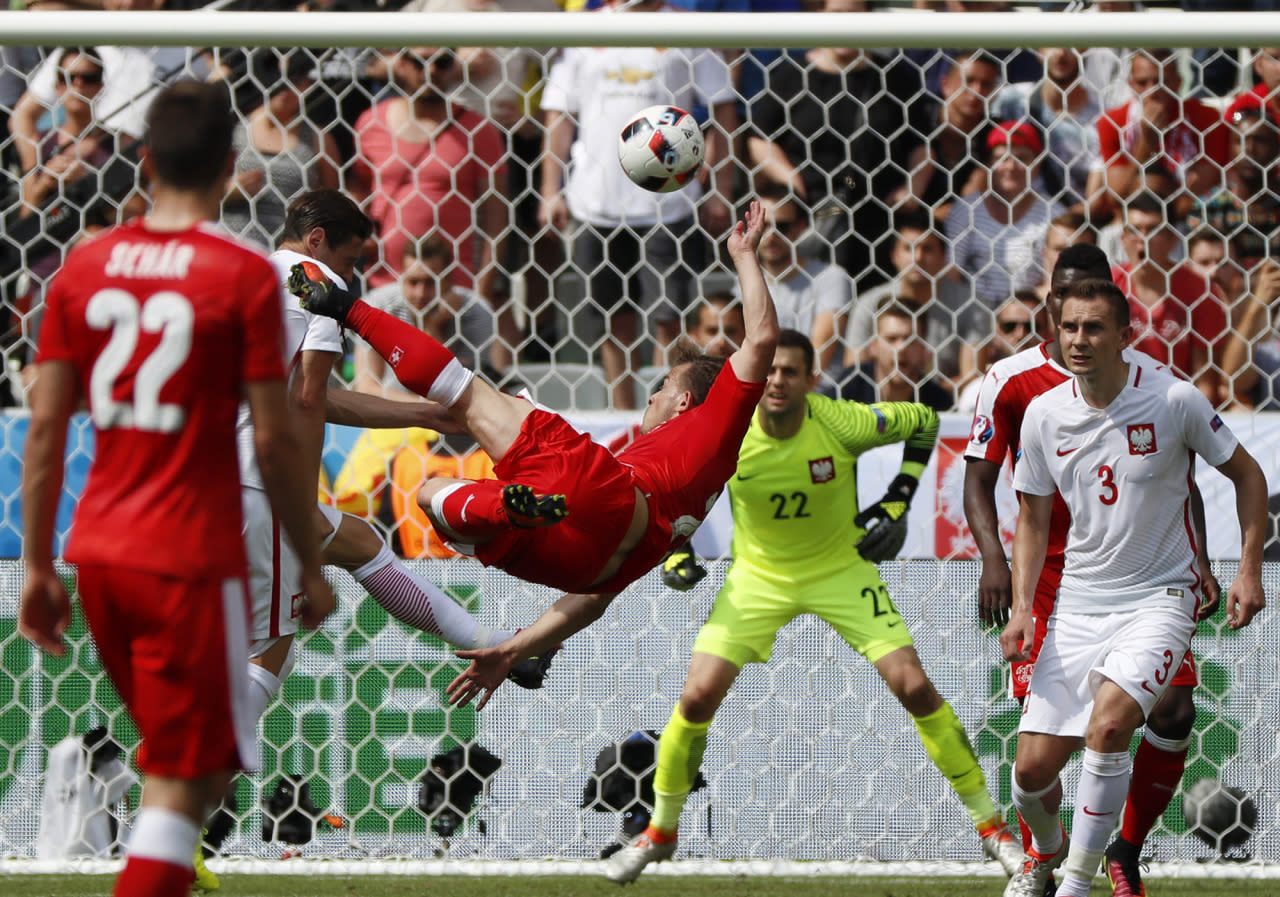 <p>Switzerland's Xherdan Shaqiri scores his side's first goal during the Euro 2016 round of 16 soccer match between Switzerland and Poland, at the Geoffroy Guichard stadium in Saint-Etienne, France, Saturday, June 25, 2016. (Photo: Darko Bandic/AP) </p>