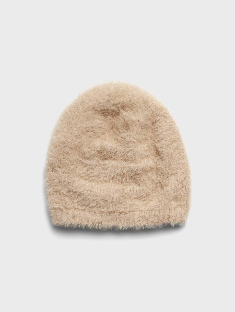 <p>Top off your winter look with a <span>Banana Republic Fuzzy Beanie</span> ($28, originally $48) in camel, white, or black.</p>