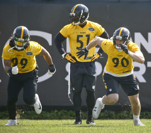 In this photo from May 24, 2018, Pittsburgh Steelers linebacker Jon Bostic (51) waits his turn to go through drills with with other linebackers T.J. Watt (90) and Keion Adams (99) during NFL football practice, Thursday, May 24, 2018, in Pittsburgh. The Steelers didn't draft an heir apparent to injured star linebacker Ryan Shazier, maybe because there really isn't one. Free agent signee Jon Bostic will take over at inside linebacker while Shazier recovers from spinal surgery, but it's more likely the Steelers use a variety of players to fill in.(AP Photo/Keith Srakocic)