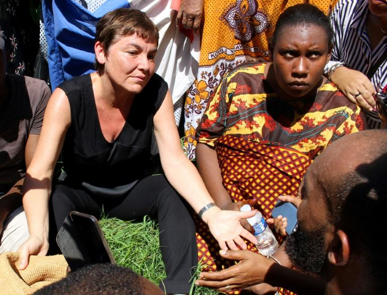 France's overseas territories minister Annick Girardin, left, met with protesters after arriving in Mayotte this week