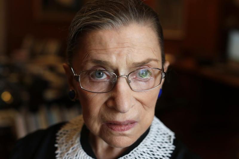 FILE - In this July 24, 2013, file photo Associate Justice Ruth Bader Ginsburg poses for a photo in her chambers at the Supreme Court in Washington, before an interview with the Associated Press. Ginsburg will officiate at a same-sex wedding this weekend in what is believed to be a first for a member of the nation's highest court. Ginsburg will officiate Saturday, aug. 31, 2013, at the marriage of Kennedy Center President Michael Kaiser and John Roberts, a government economist. Kaiser told The Associated Press he asked Ginsburg to officiate because she is a longtime friend. (AP Photo/Charles Dharapak, File)