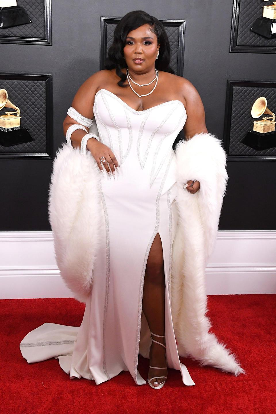 """<h2>Lizzo, 2020</h2><br>Glamorous doesn't even begin to describe this Old Hollywood-inspired Versace gown on Lizzo. <span class=""""copyright"""">Photo: Steve Granitz/WireImage.</span>"""