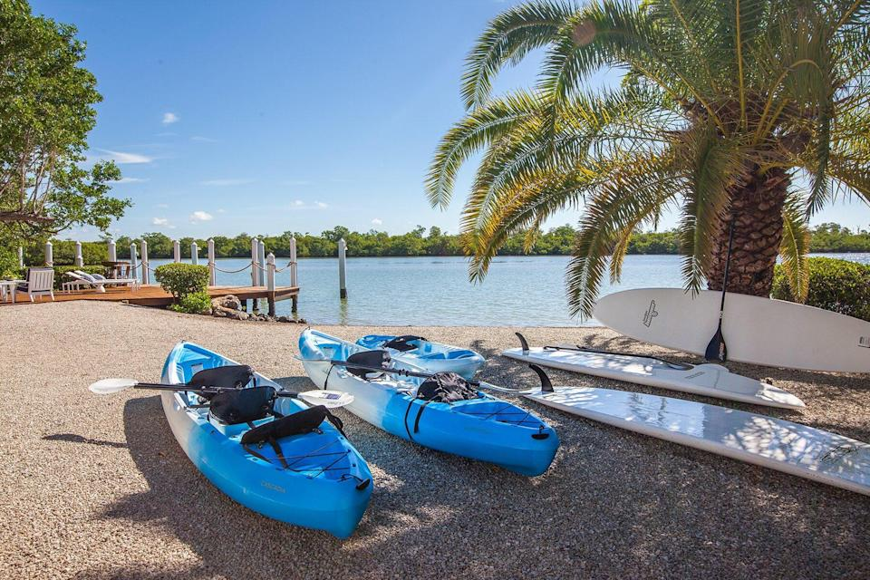A beach with kayaks at Sea Oats Luxury Estate