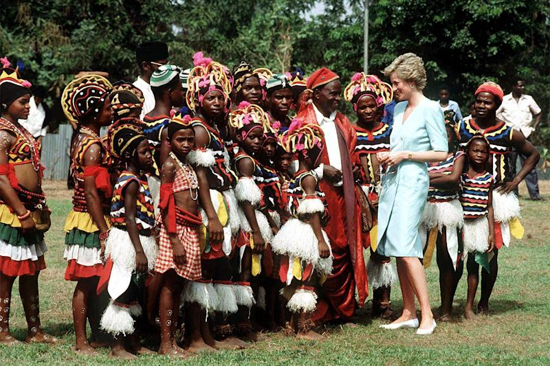 Princess Diana meets a group in traditional dress in Lagos on a royal tour of Nigeria.