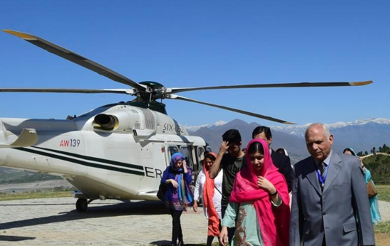 Malala Yousafzai (2R) arrived by army helicopter on her first visit to Swat valley since she was shot by the Taliban more than five years ago
