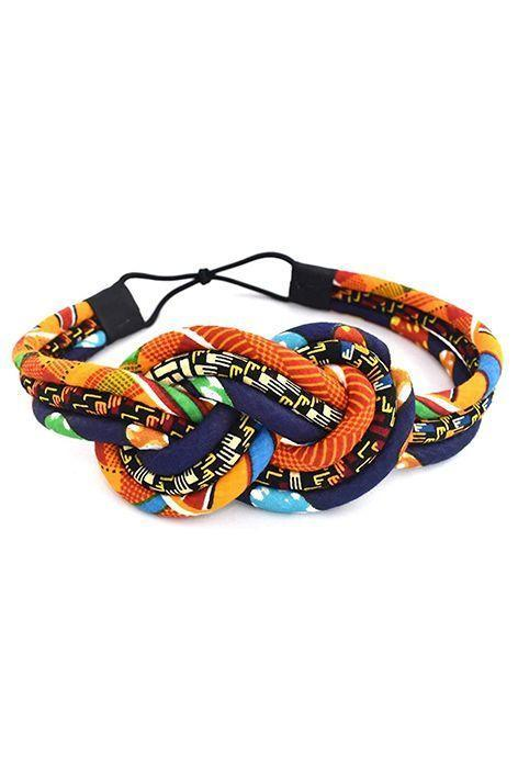 """<p><strong>Cloth & Cord</strong></p><p>amazon.com</p><p><a href=""""https://www.amazon.com/dp/B07Q84JRVS?tag=syn-yahoo-20&ascsubtag=%5Bartid%7C10072.g.33414958%5Bsrc%7Cyahoo-us"""" rel=""""nofollow noopener"""" target=""""_blank"""" data-ylk=""""slk:Shop Now"""" class=""""link rapid-noclick-resp"""">Shop Now</a></p><p>A subtle twist on the topknot headband, bright, vibrant colors are woven through this Kente print option that's handmade by artisans using Ankara fabric. With tons of stretch (the elastic itself expands to 12 inches) the statement hair accessory will accommodate most head sizes, large and small.</p>"""