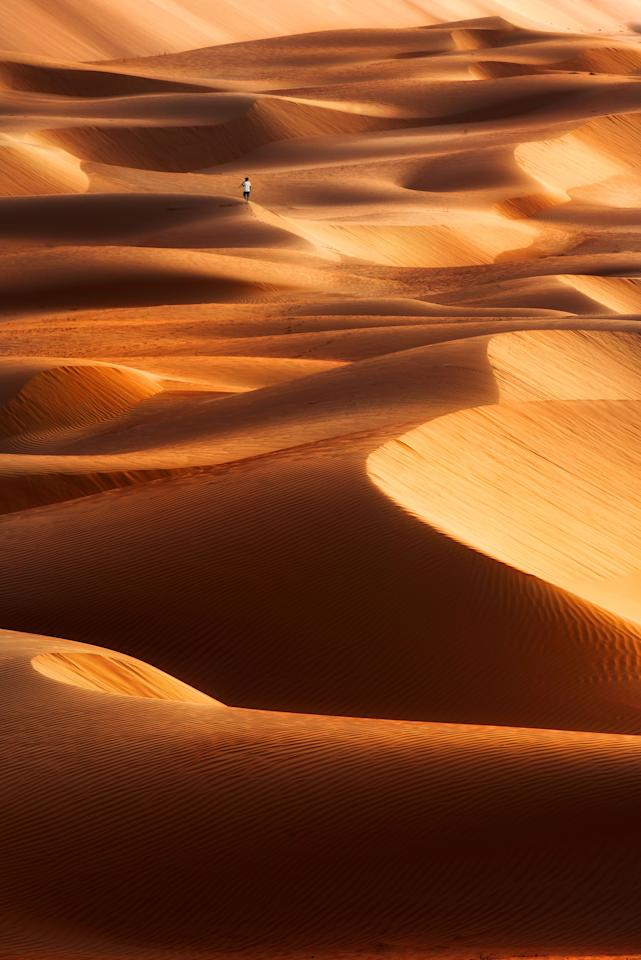 <p>The ripples in the sand's surface and the peaks and troughs of the dunes make the deserts in Dubai look like a stormy ocean. (Photo: Anushka Eranga/Caters News) </p>