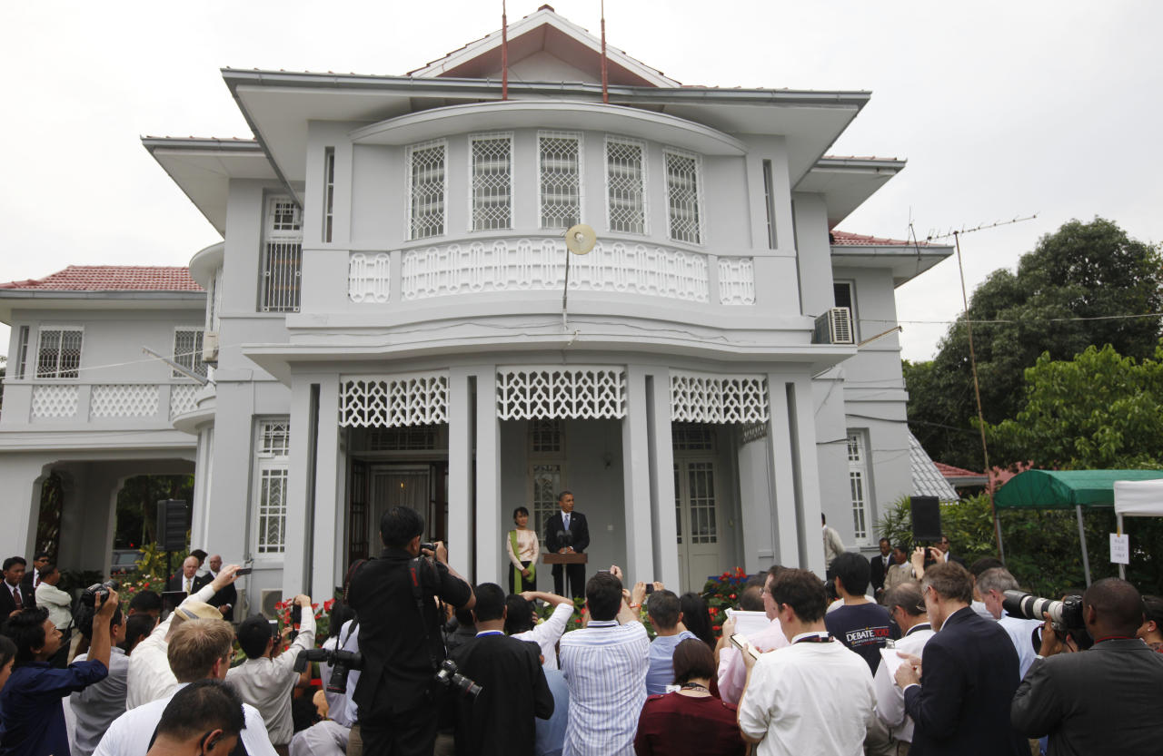 U.S. President Barack Obama and Myanmar opposition leader Aung San Suu Kyi address members of the media at Suu Kyi's residence in Yangon, Myanmar, Monday, Nov. 19, 2012. Obama who touched down Monday morning, becoming the first U.S. president to visit the Asian nation also known as Burma, said his historic visit to Myanmar marks the next step in a new chapter between the two countries. (AP Photo/Carolyn Kaster)