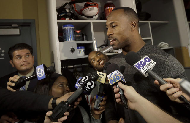 San Francisco 49ers tight end Vernon Davis, right, answers questions from reporters as wide receiver Quinton Patton smiles behind him in the locker room at an NFL training facility in Santa Clara, Calif., Monday, Jan. 20, 2014. The 49ers lost to the Seattle Seahawks in the NFC Championship Game. (AP Photo/Jeff Chiu)