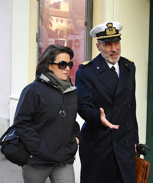 Coast Guard Capt. Gregorio De Falco, right, and his wife Raffaella arrive at the Grosseto court, Italy, Monday, Dec. 9, 2013. A Italian Coast Guard official has testified that hundreds of people were still aboard the shipwrecked Costa Concordia when the commander abandoned the cruise liner in a lifeboat. Coast Guard Capt. Gregorio De Falco become a national hero after repeatedly ordering Francesco Schettino, the Concordia's commander on trial for manslaughter and abandoning ship, to return to the badly listing vessel. Schettino is also charged with causing the 2012 shipwreck by sailing too close to the Tuscan island of Giglio. A reef gashed the hull, water rushed in and 32 people died. (AP Photo/Giacomo Aprili)