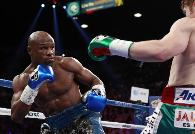 Floyd Mayweather Jr. of the U.S. fights WBC/WBA 154-pound champion Canelo Alvarez during their title fight in Las Vegas