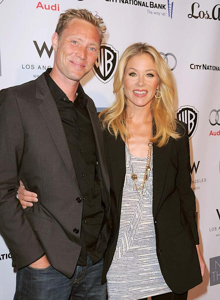"""On TV, actress Christina Applegate plays a new mom in the sitcom """"Up All Night"""" -- not too much of a stretch for the 40-year-old! First-time mother Applegate and her fiance Martyn LeNoble welcomed daughter Sadie Grace on January 27."""
