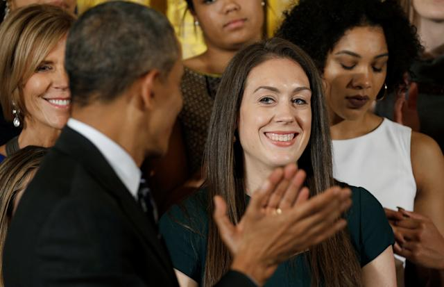 U.S. President Barack Obama applauds star player Breanna Stewart (R) as he honors the University of Connecticut (UConn) Huskies women's basketball team for their 2016 NCAA Championship during a ceremony at the White House in Washington May 10, 2016. REUTERS/Kevin Lamarque