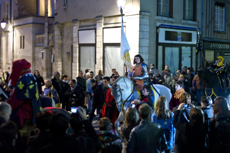 Pauline Finet performs as Joan of Arc during the opening ceremony of the 600th anniversary of the birth of Joan of Arc, in Orleans, central France, Sunday April 29, 2012. The city of Orleans goes all out with celebrations marking the 600th birthday of Joan of Arc, a national icon and symbol of French resistance through the ages at a time when French identity and France's role in the world are a focus in the presidential campaign.  (AP Photo/Thibault Camus)