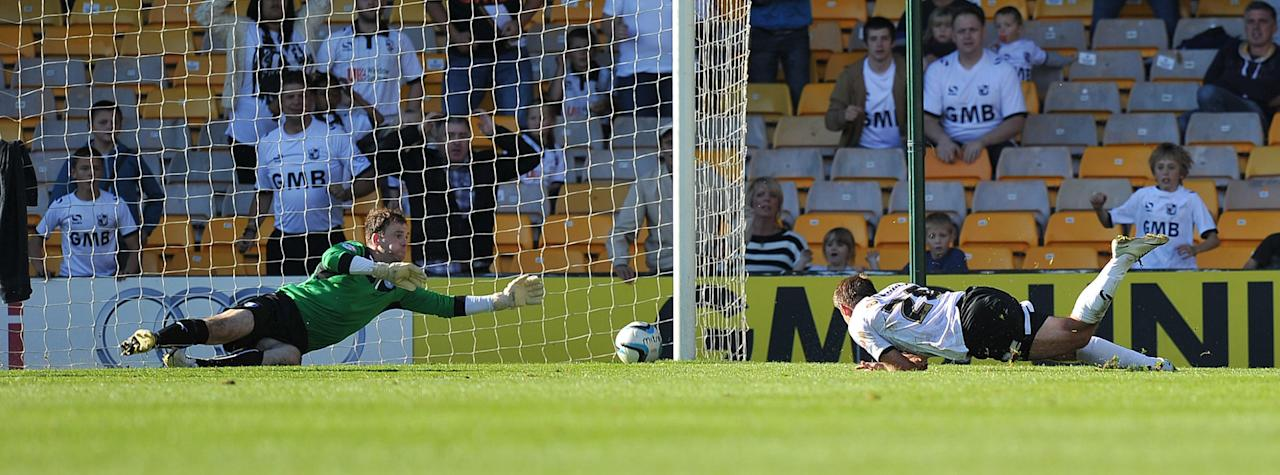 Port Vale's Chris Birchall (right) scores the winning goal during the Sky Bet League One match at Vale Park, Stoke.