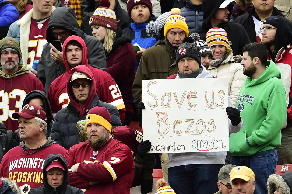 LANDOVER, MD - NOVEMBER 17: A fan holds up a sign for CEO and founder of Amazon Jeff Bezos during a game between the New York Jets and Washington Redskins at FedExField on November 17, 2019 in Landover, Maryland. (Photo by Patrick McDermott/Getty Images)