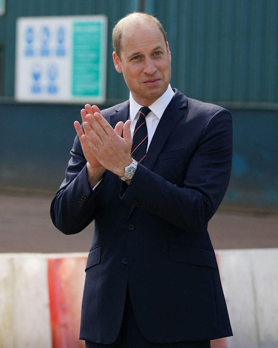 <p>Prince William applauds workers on HMS Glasgow at the BAE Systems shipyard. </p>