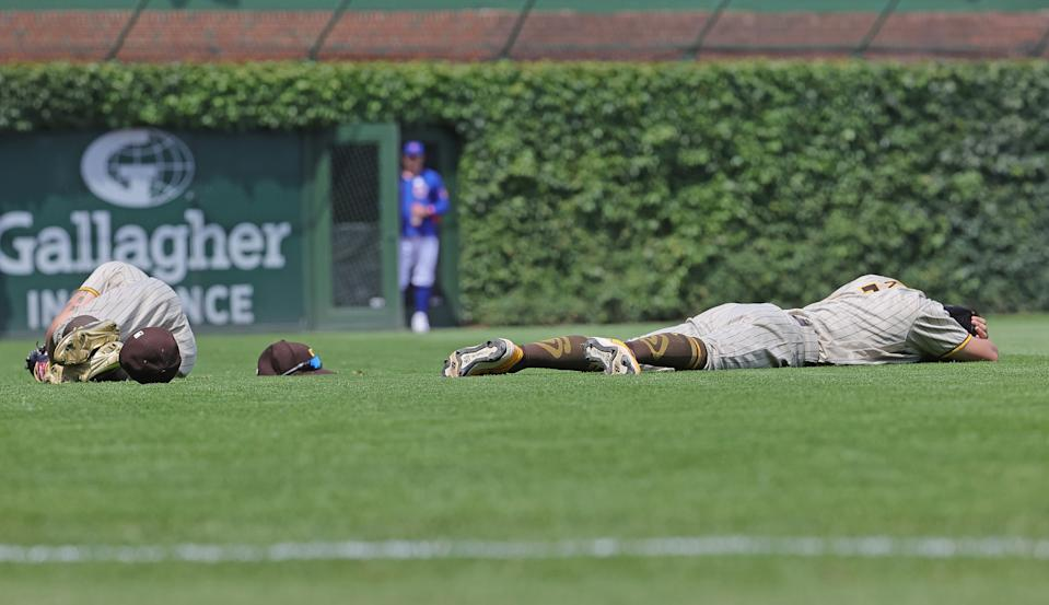 Padres' Tommy Pham and Ha-Seong Kim after colliding against the Cubs