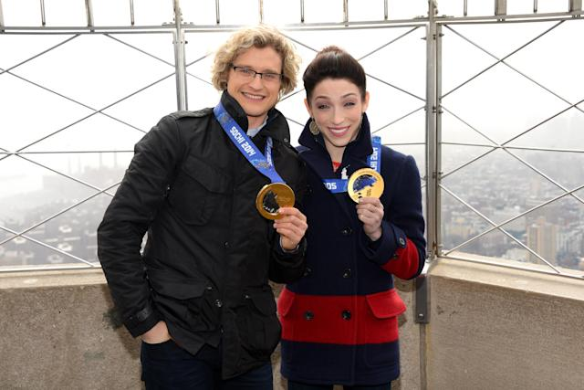 Olympic gold medalist ice dancers Meryl Davis and Charlie White, left, visit the Empire State Building on Thursday, Feb. 27, 2014 in New York. (Photo by Evan Agostini/Invision/AP)