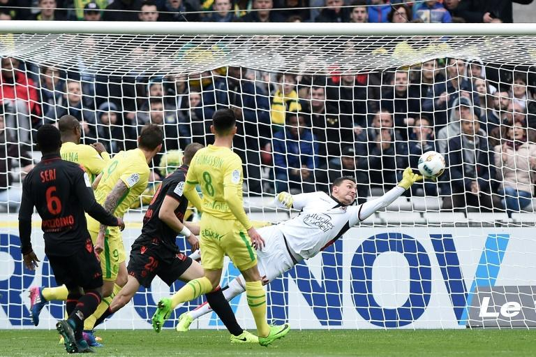 Nantes' forward Emiliano Sala (L) scores a goal during the French L1 football match against Nice on March 18, 2017