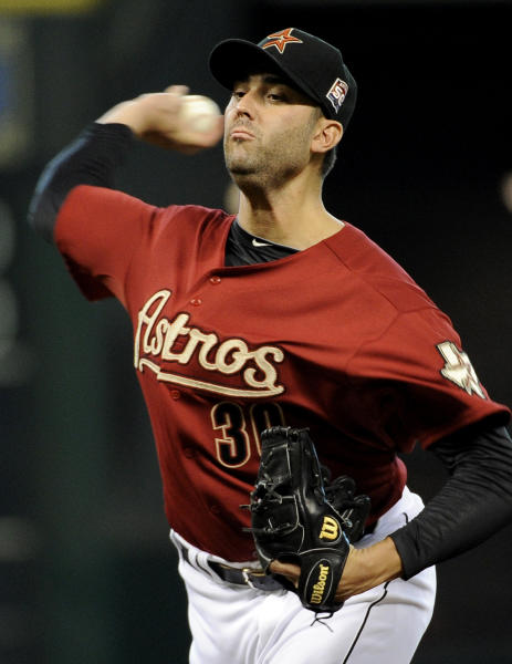 Houston Astros' Armando Galarraga delivers a pitch against the Arizona Diamondbacks in the first inning of a baseball game on Sunday, Aug. 19, 2012, in Houston. (AP Photo/Pat Sullivan)