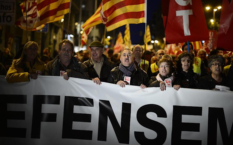 People protest against austerity measures, including Spanish state pensions in Barcelona, Spain, Monday, Dec. 17, 2012. The demonstrations have been called by the country's main labor unions and a wide array of social movement groups. (AP Photo/Manu Fernandez)
