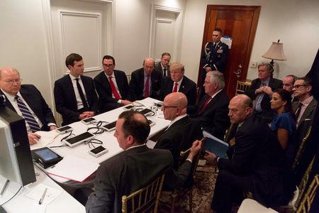 U.S. President Trump is shown in an official White House handout image meeting with his National  Security team at his Mar-a-Lago resort after a missile strike on Syria