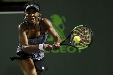 Mar 29, 2017; Miami, FL, USA; Venus Williams of the United States hits a backhand against Angelique Kerber of Germany (not pictured) on day nine of the 2017 Miami Open at Crandon Park Tennis Center. Williams won 7-5, 6-3. Mandatory Credit: Geoff Burke-USA TODAY Sports