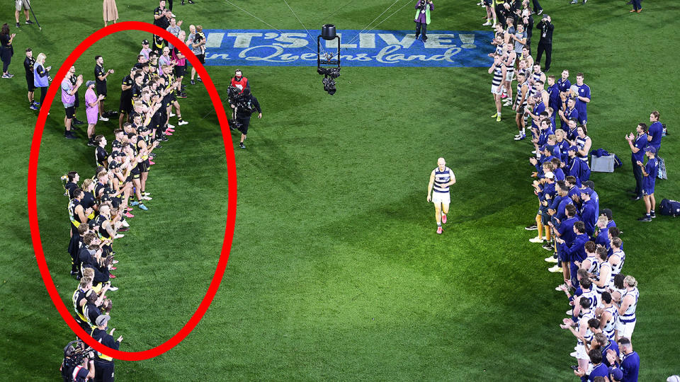The Richmond Tigers and Geelong Cats are pictured giving retiring AFL player Gary Ablett Jr a guard of honour.