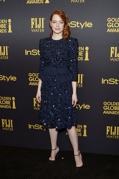 <p>The actress channeled vintage Hollywood glamour with her bedazzled navy blue frock and side swept hairstyle. (Photo: Getty Images) </p>