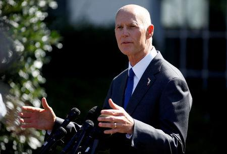 FILE PHOTO:    Florida Governor Rick Scott speaks about hurricane relief measures for Florida and Puerto Rico at the White House in Washington