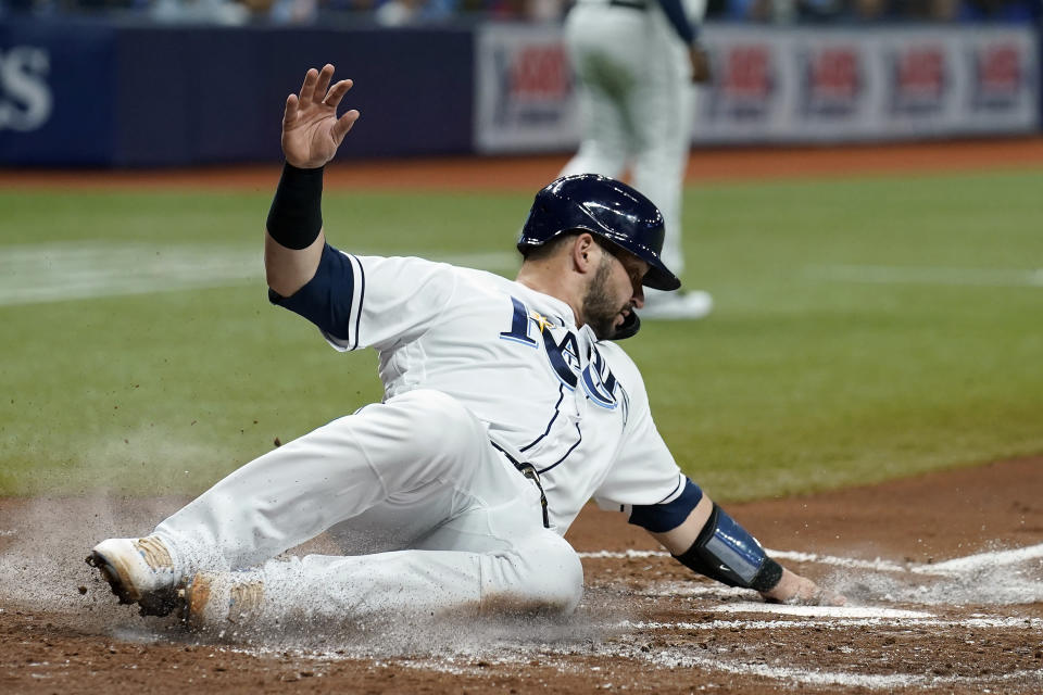 Tampa Bay Rays' Mike Zunino scores on an RBI single by Brandon Lowe off Toronto Blue Jays starting pitcher Alek Manoah during the second inning of a baseball game Tuesday, Sept. 21, 2021, in St. Petersburg, Fla. (AP Photo/Chris O'Meara)