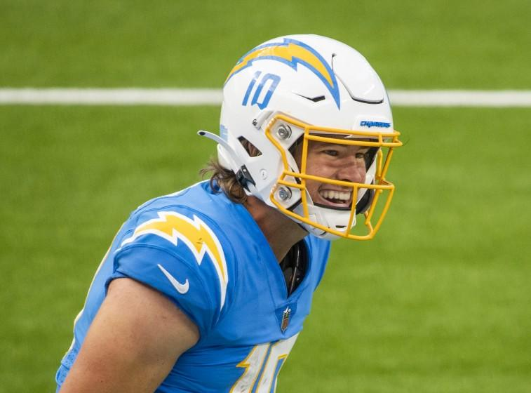 INGLEWOOD, CA - OCTOBER 25: Chargers quarterback Justin Herbert, #10, celebrates with teammates his five-yard touchdown run to put the Chargers up for good with five seconds remaining in the third quarter at an empty SoFi Stadium on Sunday, Oct. 25, 2020 in Inglewood, CA. Herbert's 66 yards set a franchise record for rushing yards by a quarterback. (Allen J. Schaben / Los Angeles Times)