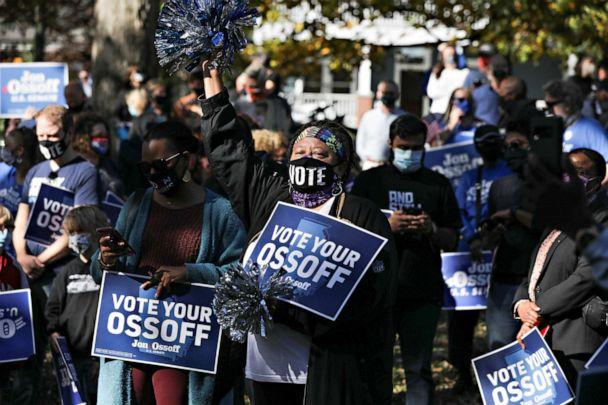 PHOTO: Supporters listen as Democratic U.S. Senate candidate Jon Ossoff speaks at a news conference in Grant Park after the election in Atlanta, Nov. 6, 2020. (Dustin Chambers/Reuters)