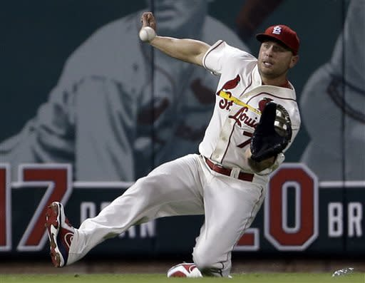 St. Louis Cardinals left fielder Matt Holliday slides and catches a ball hit by Texas Rangers' Ian Kinsler for an out during the fifth inning of a baseball game on Saturday, June 22, 2013, in St. Louis. (AP Photo/Jeff Roberson)