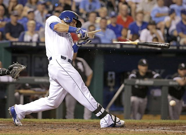 Kansas City Royals' Alex Gordon breaks his bat as he grounds out during the sixth inning of a baseball game against the Chicago White Sox on Wednesday, May 21, 2014, in Kansas City, Mo. (AP Photo/Charlie Riedel)