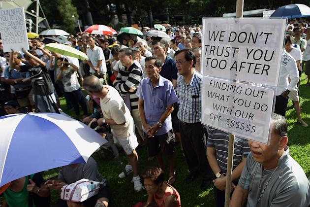 SINGAPORE - JUNE 07: People gather to listen to a speaker during the 'Return Our CPF' protest at the Speakers' Corner at Hong Lim Park on June 7, 2014 in Singapore. The protest was staged to demand greater transparency and accountability from the government on how the CPF monies are being utilized. (Photo by Suhaimi Abdullah/Getty Images)