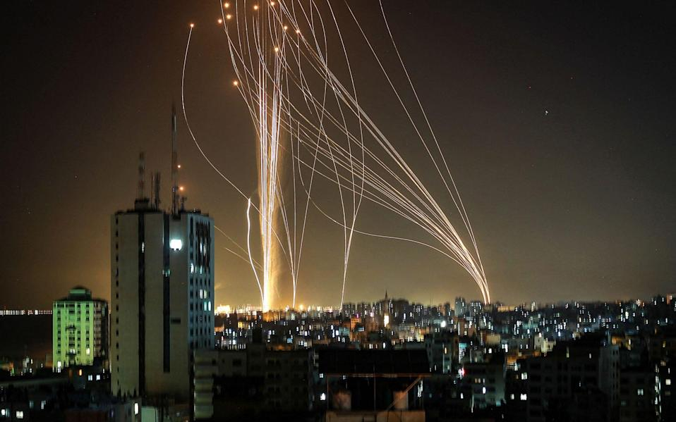 Rockets are launched from Gaza city, controlled by the Palestinian Hamas movement, in response to an Israeli air strike on a 14-storey building in the city, - AFP