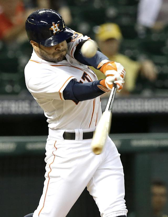 Houston Astros' Jose Altuve fouls off a ball in the third inning of a baseball game against the Oakland Athletics Monday, Aug. 25, 2014, in Houston. Altuve grounded into a force out on the play. (AP Photo/Pat Sullivan)