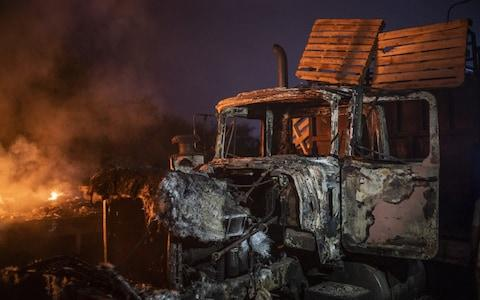 A burnt truck previously loaded with humanitarian aid sits on the Francisco De Paula Santander International Bridge near the border with Venezuela in Cucuta - Credit: Bloomberg
